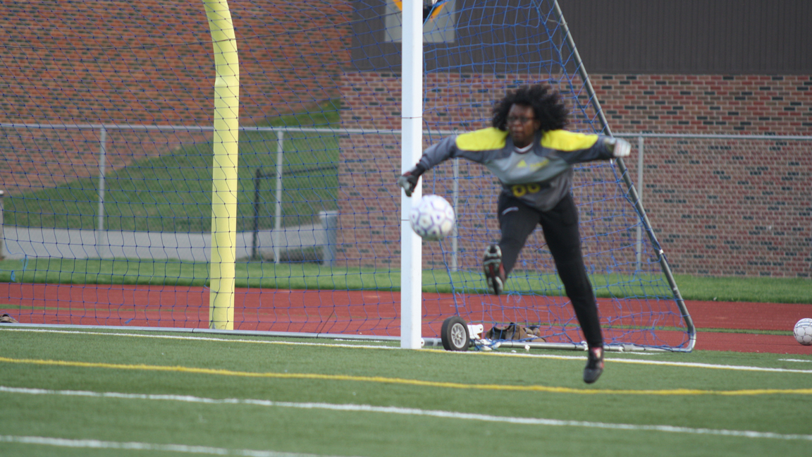 Goalie sophomore Khadijat Badejo kicks to stop the Pirates from scoring a goal. Photo by Kenneth Watson.