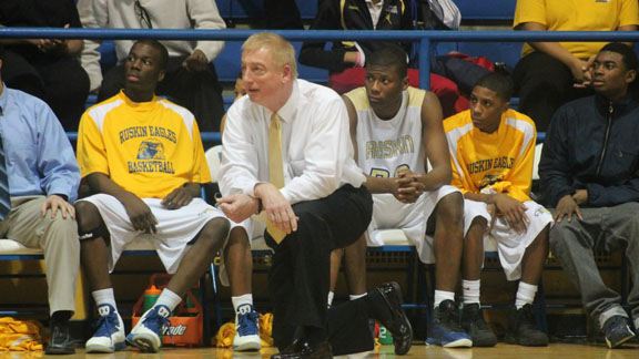 Coach Gerry Marlin gives instructions to his Eagles Basketball team during the game against Park Hill, which would be his 500th career win. Photo by John Baccala.