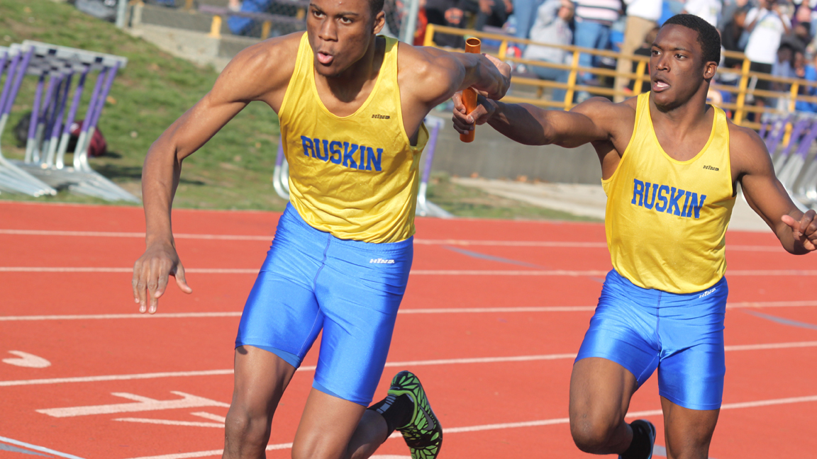 Sophomore Montel Berry hand the baton to Senior Kevin Brown during a relay race at the Kearney Classic. The two, along with Bobby Neal and Justin Martin won the 4 x 200 and helped their team win the Classic. Photo by Rickie Wiley.