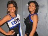 Alexus Butts (left) getting ready to dance for the game with her sister, Rodnesha Butts.