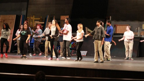 """Little Shop of Horrors"" chorus members rehearse dance choreography on stage.""Photo by Jasmine Shelton"