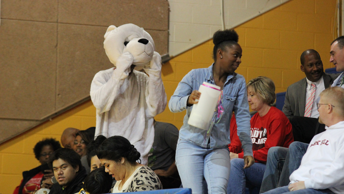 Senior Tranae Lauderdale asks for donations for Polar Plunge during a Girl's Varsity Basketball game.