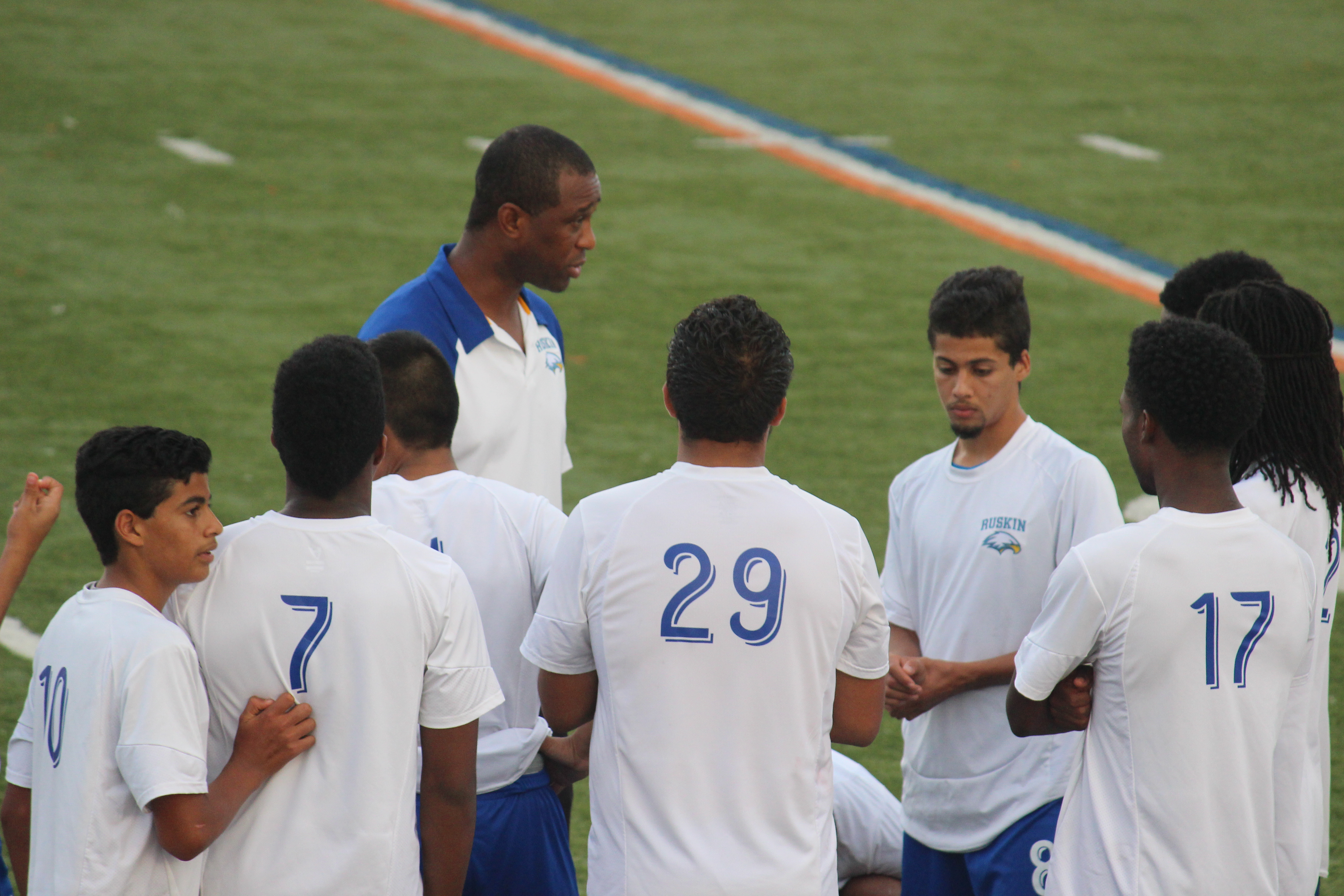"""Soaring For Success The Ruskin Eagles Boys Soccer Team gathers for a pre-game talk to pump up the boys' spirits. The team practiced countless hours to perfect their playing techniques. Those techniques come into play when the team gives it their all on the field. """"We basically go over working as a team and trying to master our team playing abilities."""" senior Robert Johnson said. Photo by Madeline Harris."""
