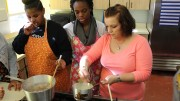 FACS teacher Michelle Ciafullo helps students sophomore Dejehaunna Clark and junior Tonesha Parker cook Alfredo in Nutrition and Wellness on Wednesday, Dec. 9.