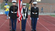 Junior Jayme Parman (right) serves as Color Guard with juniors Allison Rainey (center) and Zachary Laughery  (right) at a Friday night football game. Parman was recently named Athlete of the Week for her dedication and work in the MJROTC.