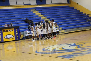 Coach Brian Harris talks to his team during a timeout on Nov. 28 against Belton. The Lady Eagles C Team beat the Pirates 41-7 during their home opener. Photo Credit: Jasmine Shelton-Stanley