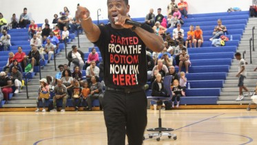 Giving a motivational speech to students and teachers, Dr. Adolph Brown was the guest speaker. The Back to School rally took place at Hickman Mills Aug. 5.  Photo Credit: Kaylah Carter