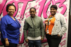 Journalism teacher Robyn King, also known as Robyn Knight on Hot 103 Jamz, Bre-Z, and senior Destnee Walton pose for a picture after Walton's interview with Bre-Z. Bre-Z starred on Empire as Freda Gatz. Photo Credit: Robyn King