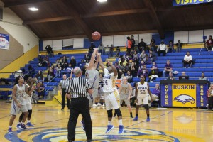 """Reaching for the tip-off, junior Tamya McCray starts the season home opener against Belton. The Lady Eagles fought to the end but lost 39-36. """"I felt confident and I thought we were going to win but it was a close game,"""" McCray said. Photo Credit: Destnee Walton"""